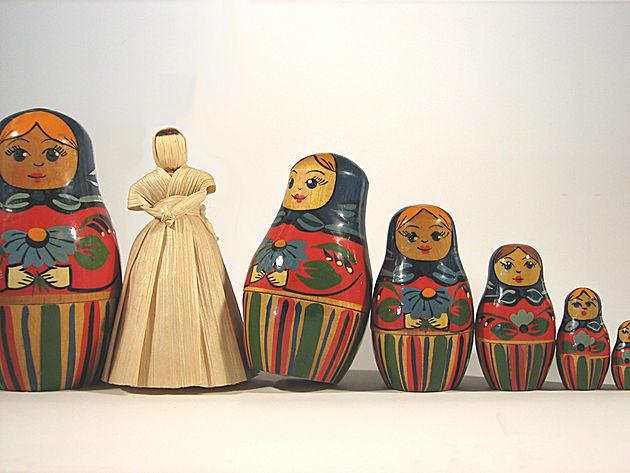 Wicker doll in between russian dolls